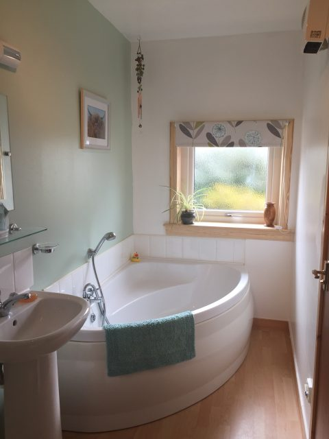 ensuite bathroom with fabulous corner bath