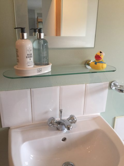 ensuite bathroom with toiletries
